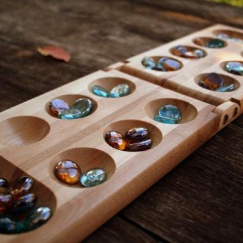 المنقلة – من أقدم ألعاب الطاولة العربية